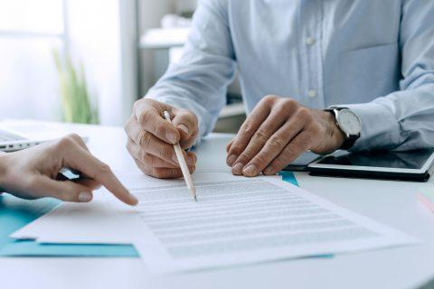 two people looking over insurance documents