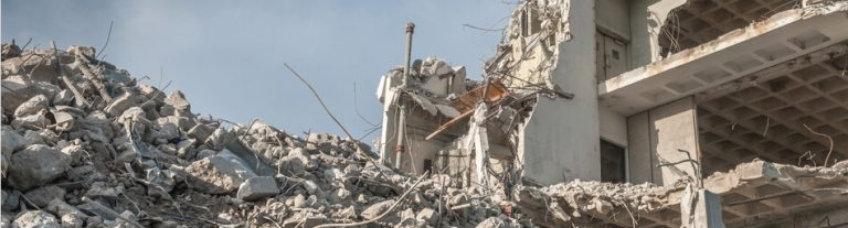 destroyed building with rubble