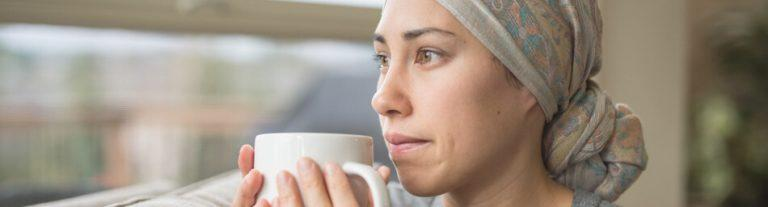 Worried cancer patient holding a coffee mug