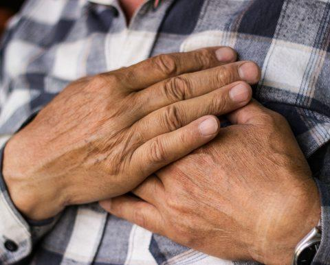 Chest pain caused by asbestosis.
