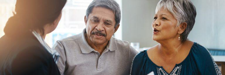 Patient and husband talking with doctor.