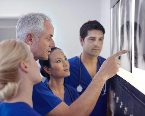 Doctors looking at a chest x-ray.