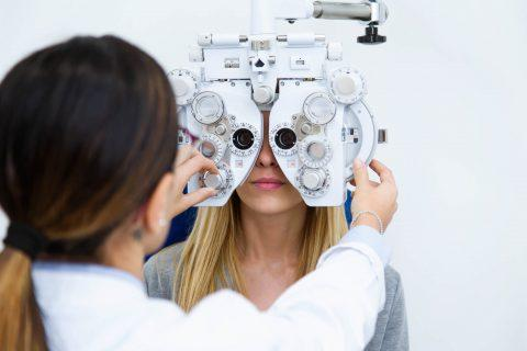 Woman receives eye examination from doctor