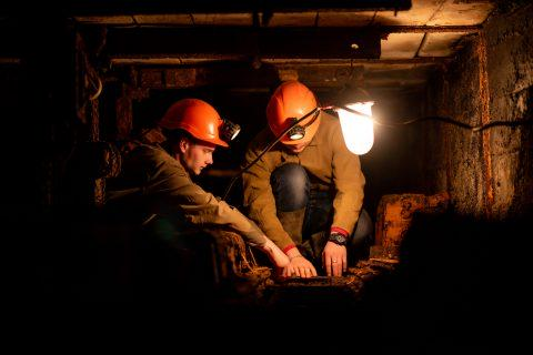 Two miners working underground