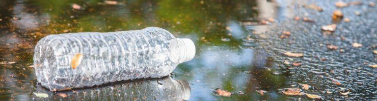 plastic bottle contaminating water source