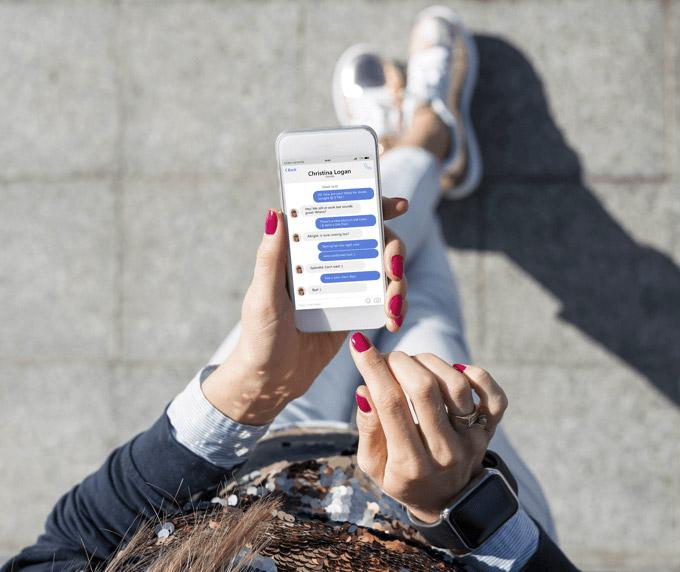 Woman using social media apps on a smartphone